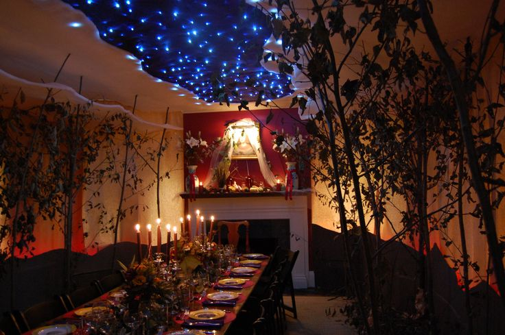 Decoration, Awesome Halloween Living Room With Blue Lighting Ceiling And Long Wooden Table For Halloween Party Also Dark Scheme Dining Room With Candle Light And Scream Nuance Also Classic Fireplace On Dining Room: Astounding Halloween Dinner Party Ideas