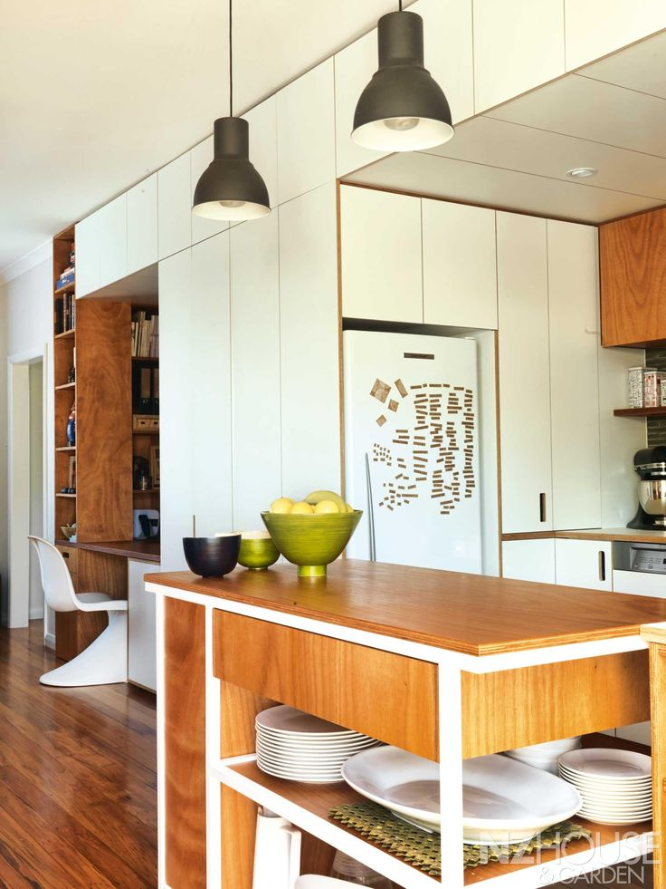 CREATIVE DESIGN Money Was Saved On Making Bespoke Kitchen Cabinetry From A Plywood Substrate Cut To Shape Which Cleverly Hides Filing Cabinets As Well