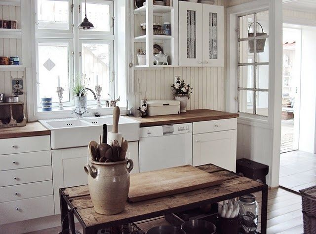 Literally my perfect kitchen--white cabinets, open shelving & glass cabinets, butcher block countertop, apron sink, wood island.