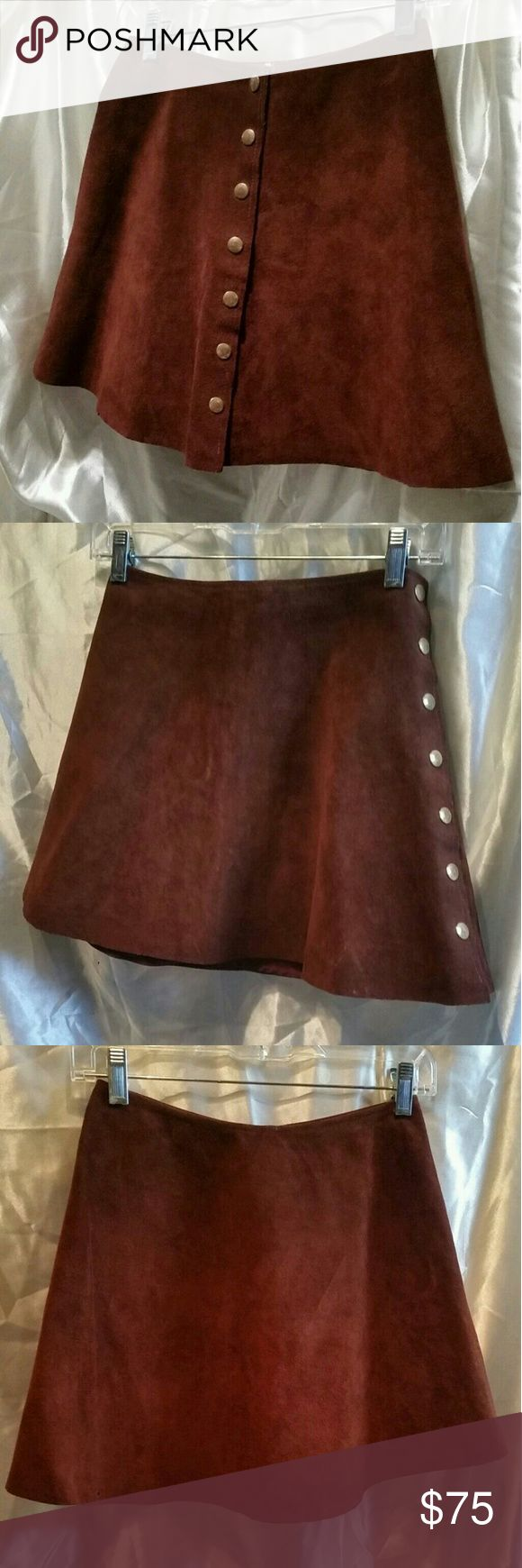"""Vintage Suede Snap Up Fit & Flare Mini Skirt VINTAGE CHOCOLATE BROWN SUEDE SNAP UP FLARE MINI SKIRT. CAN ALSO BE WORN SNAPPED AT SIDE.  SIZE XS TO SMALL, MEASURES:  12.5"""" ACROSS WAIST AND 14.75"""" LONG.  UNLINED, NO LABELS PRESE T.  IN VERY STRONG VINTAGE CONDITION, SOME LIGHT SURFACE SMUDGES AS PICTURED, MAY BRUSH OUT NICELY, I HAVE NOT TRIED.  ANY QUESTIONS OR CONCERNS, PLEASE ASK AS ALL SALES ARE FINAL.  THANKS FOR LOOKING. Unbranded Skirts Mini"""