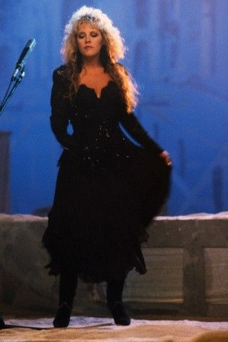 Back in black: from the 'Seven Wonders' video, Stevie Nicks in signature flowing black ensemble and towering boots.