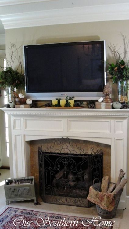 I need a mantle for our fireplace! And I love how this one is decorated for fall, even with a TV above it! Click to check a cool blog!Source for the post: Click