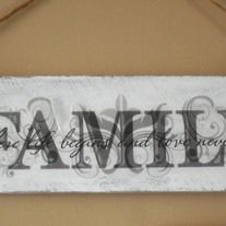"Charming wall hanging made from repurposed pallet wood painted distressed white and has decal that say "" Family "" in large print and in small print says ""where life begins and love never ends "". Measures 20 long and 5.5 wide and hangs from rope."