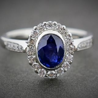 VIVID BLUE SAPPHIRE HALO A vivid blue natural sapphire and diamond halo ring set in Platinum. #Engagement #Sapphire #PlatinumCork