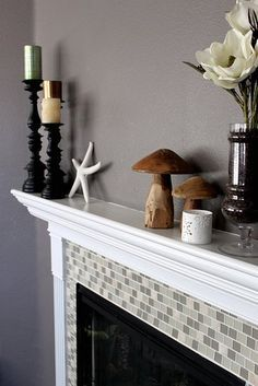 Fireplace Remodel...Love the glass tiles around a fireplace
