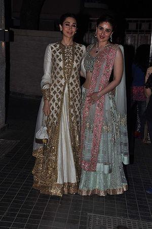 Soha Ali Khan's Wedding Reception - Karishma Kapoor in a white and gold Manish Malhotra & Kareena Kapoor in mint and pink Manish Malhotra. Indian celebrity wedding #thecrimsonbride