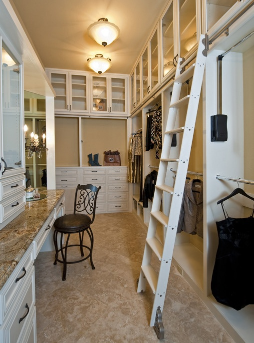 Master closet with a rolling ladder.. with all the clothing ike & i have, this is a MUST