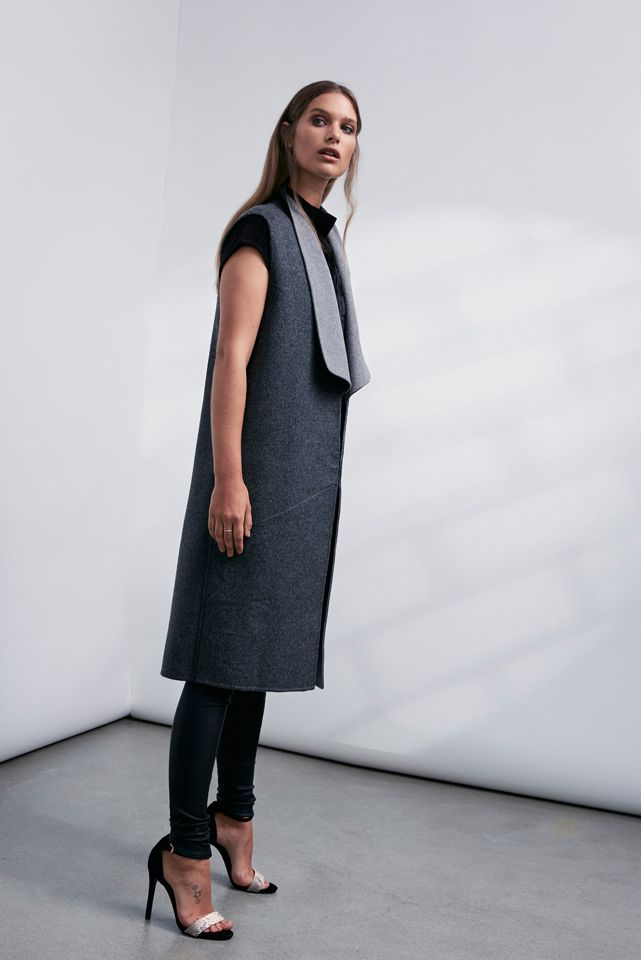 OnceWas: Collectible sleeveless wool vest, Yumi fur front funnel neck knit and Fortune quilted stretch leather pant.