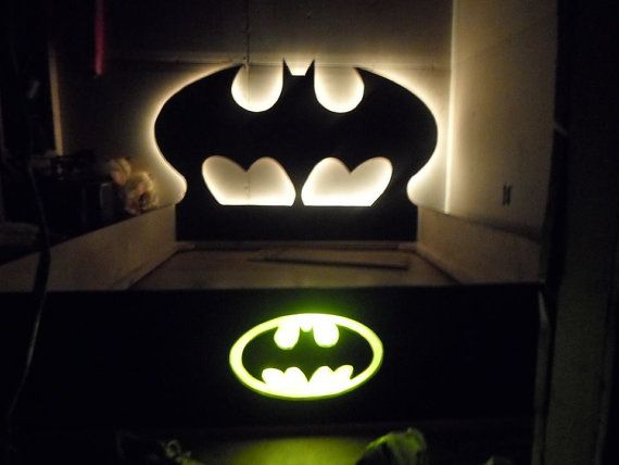 The child in your life will enjoy falling to sleep each night in this adorable handcrafted superhero Batman bed. This listing includes the headboard, foot board, slats, rails, and all necessary screws for assembly. The only thing you need to add is the mattress & box springs! The
