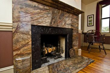 Rainforest Green Granite & Leathered Antique Brown Granite fireplace surround traditional-living-room