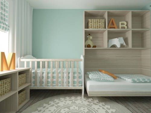 Cool way to tuck a baby's crib into a small space in the master bedroom. It's amazing what parents with a little creativity can do.