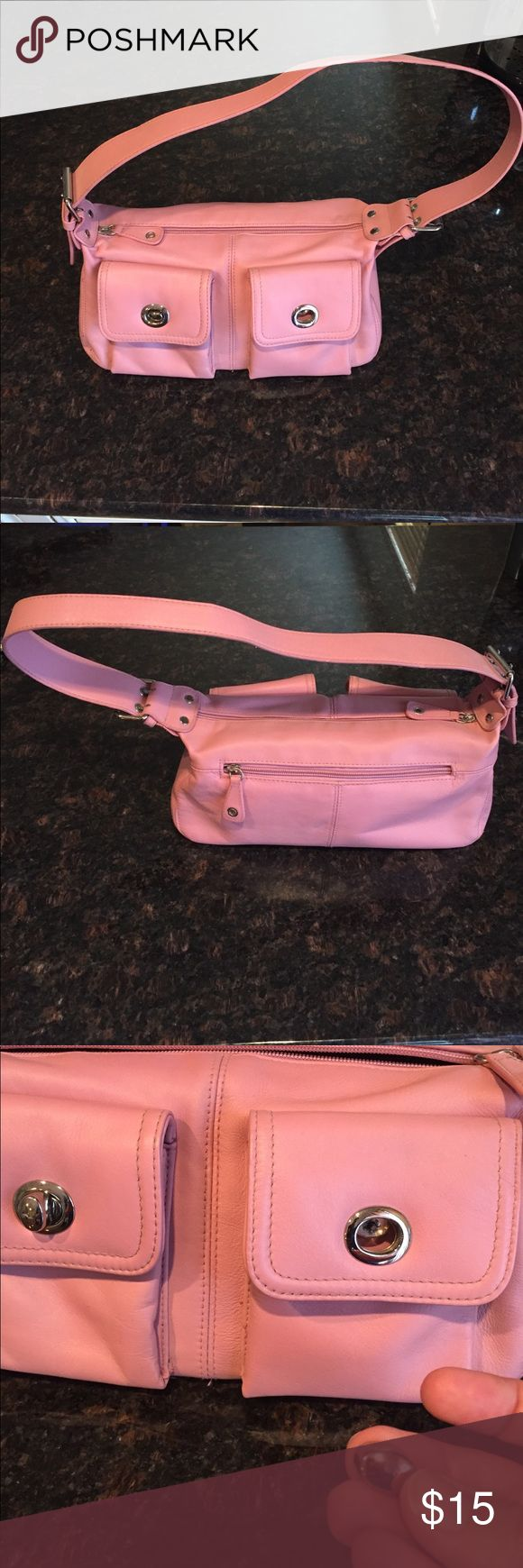 Apostrophe shoulder bag Very cute bag from Sears in the perfect shade of pink. Has two outside pockets with turnlock closures. Turning part of one of the locks has come off and can probably be reattached. Under each flap is a bit of discoloration which can probably be cleaned. Backside of the bag has a zipper pocket. There is also a zipper to the main compartment. Inside is a black lining with pink polka dots, another zipper pocket, two slip pockets and slots for ID and credit cards…