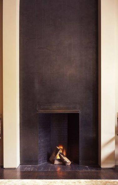 Black plaster fireplace.