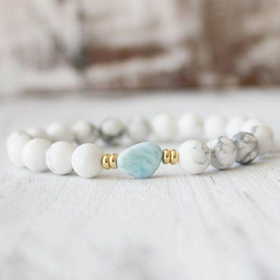 Calming Larimar Bracelet Simple and unique. Perfect for Everyday    Details:  8mm High quality white howlite.  Genuine Larimar nugget guru