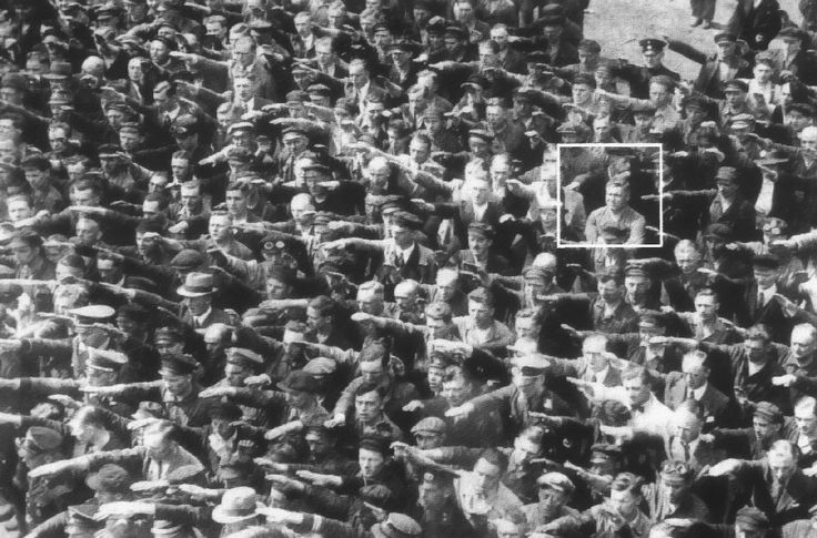 """Hamburg, 1936 ~ """"during celebrations for the launch of a ship. In the crowd, one person refuses to raise his arm to give the Nazi salute...August Landmesser. He had already been in trouble with the authorities, sentenced to two years hard labor for marrying a Jewish woman. We know little else about August Landmesser, except that he had two children. By chance, one of his children recognized her father in this photo when published in a German newspaper in 1991. How proud she must have…"""