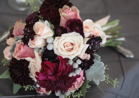 """I like the deep reds combined with the blush pink in this arrangement. I also like that this does not have a lot of the light grey/green foilage (not sure what it is called) that many of the other """"romantic"""" bouquets seem to have."""