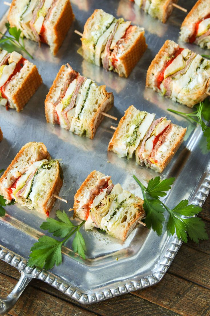 Densly packed with classic antipasti ingredients, this sandwich is vibrantly flavored. Serve these sandwich bites as an appetizer, take them on a picnic or a hike, or brown bag them for an awesome workday lunch.