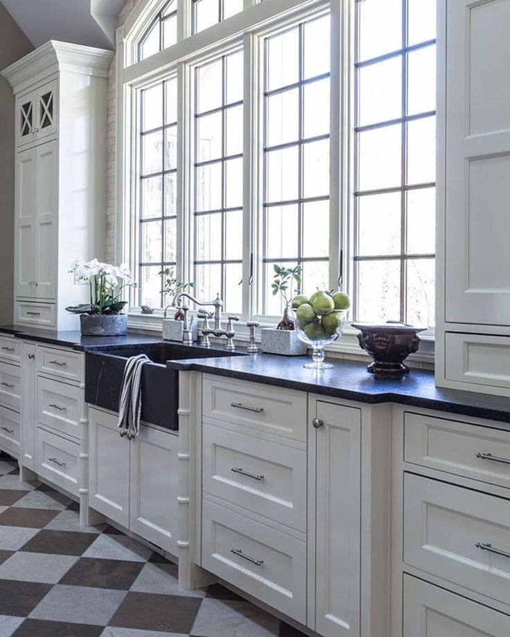 Large kitchen with modern amenities, flooded with natural light. However, arcade windows cost a pretty penny even when made from synthetic materials.