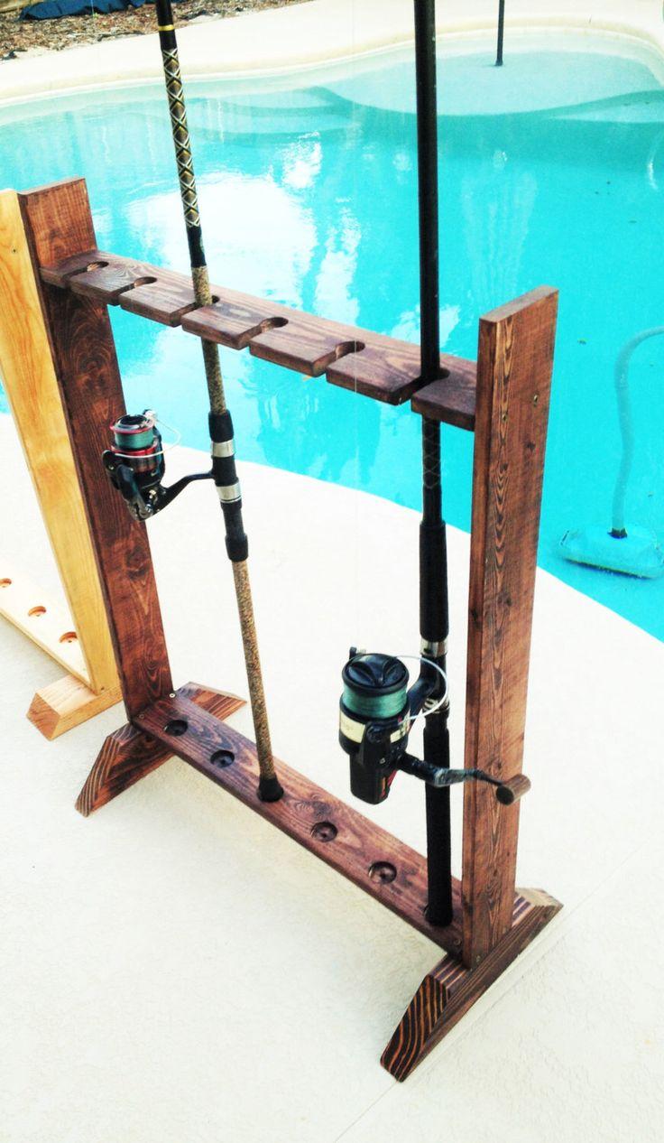 Fishing pole Rod Holder/Organizer by FiercesFixins on Etsy https://www.etsy.com/listing/224755100/fishing-pole-rod-holderorganizer