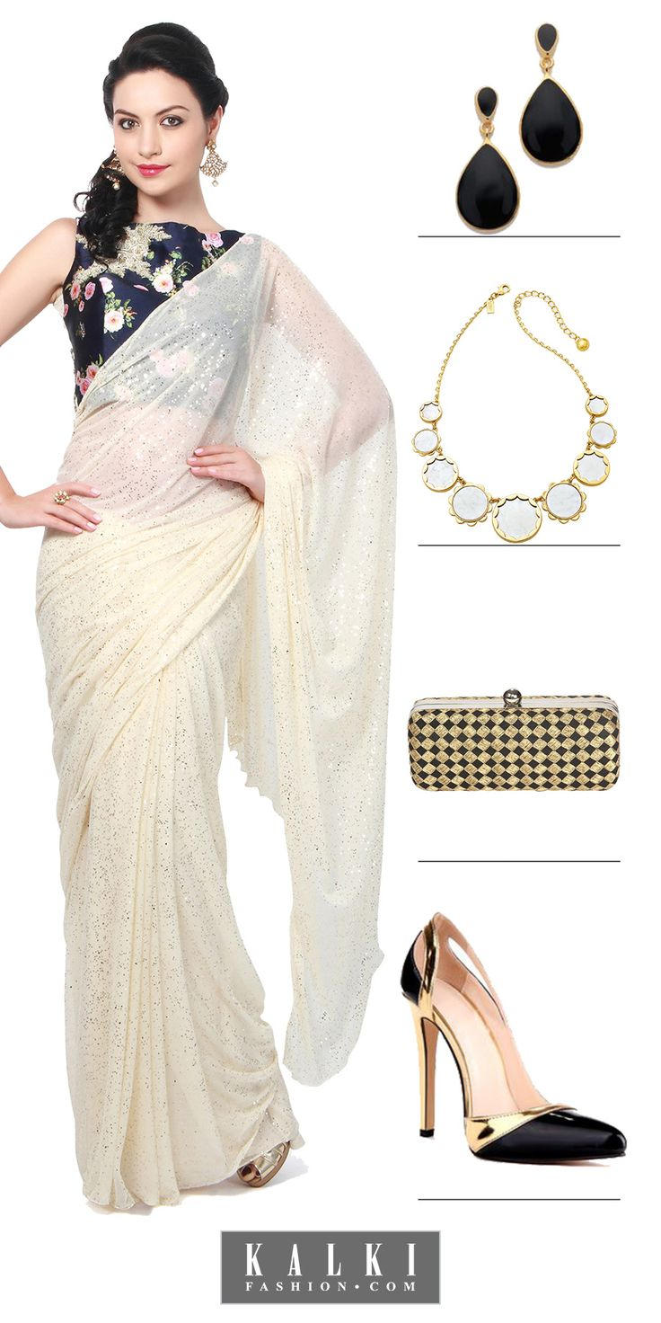 Contrasting shades like blue and off-white look charmingly beautiful with each other. The mod-navy blue floral blouse with gleaming off-white saree gives the perfect party look. Create the aura of elegance with bracelet and elegant gold and white earrings. Go to a party and allure everyone with subtle chic beauty.