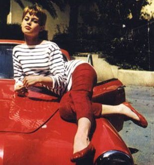 Bridgit Bardot hanging out on a car. A litte stripes, a lot of red. Not bad.