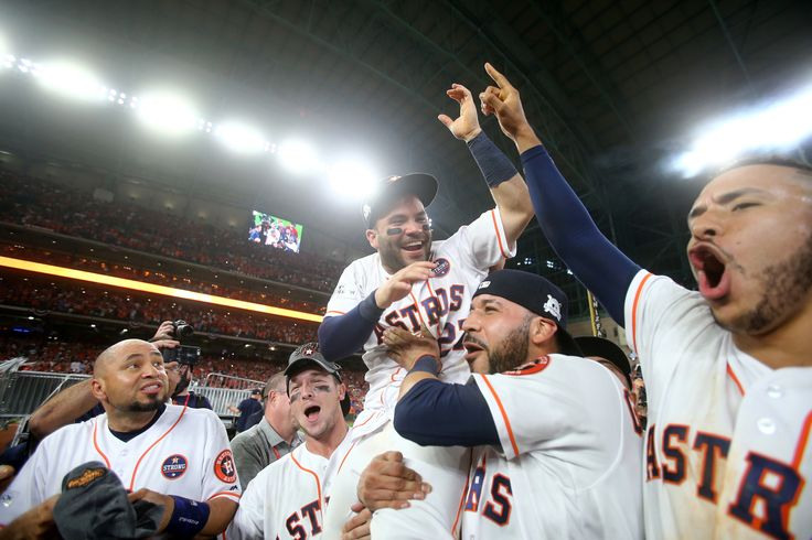 October 21, 2017:  Houston Astros advance to World Series after defeating Yankees 4-0 in ALCS Game 7.  HOUSTON, TX - OCTOBER 21: Jose Altuve #27 of the Houston Astros celebrates with Alex Bregman #2, Marwin Gonzalez #9 and Carlos Correa #1 after defeating the New York Yankees by a score of 4-0 to win Game Seven of the American League Championship Series at Minute Maid Park on October 21, 2017 in Houston, Texas. The Houston Astros advance to face the Los Angeles Dodgers in the World Series.