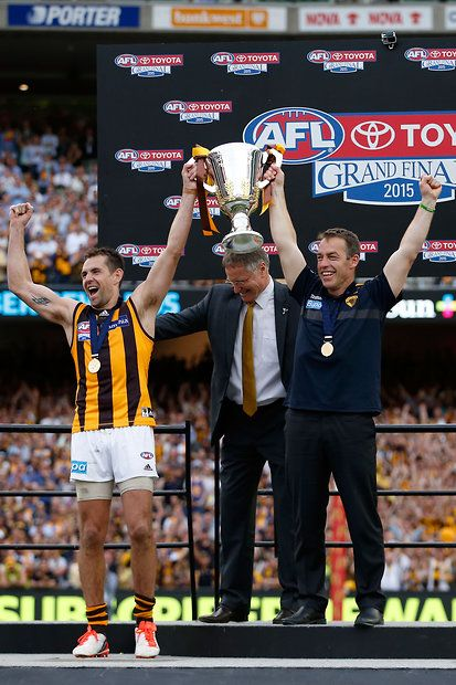 2015 Toyota AFL Grand Final - Hawthorn v West Coast - Hawthorn captain Luke Hodge and coach Alastair Clarkson hold up the Premiership Cup