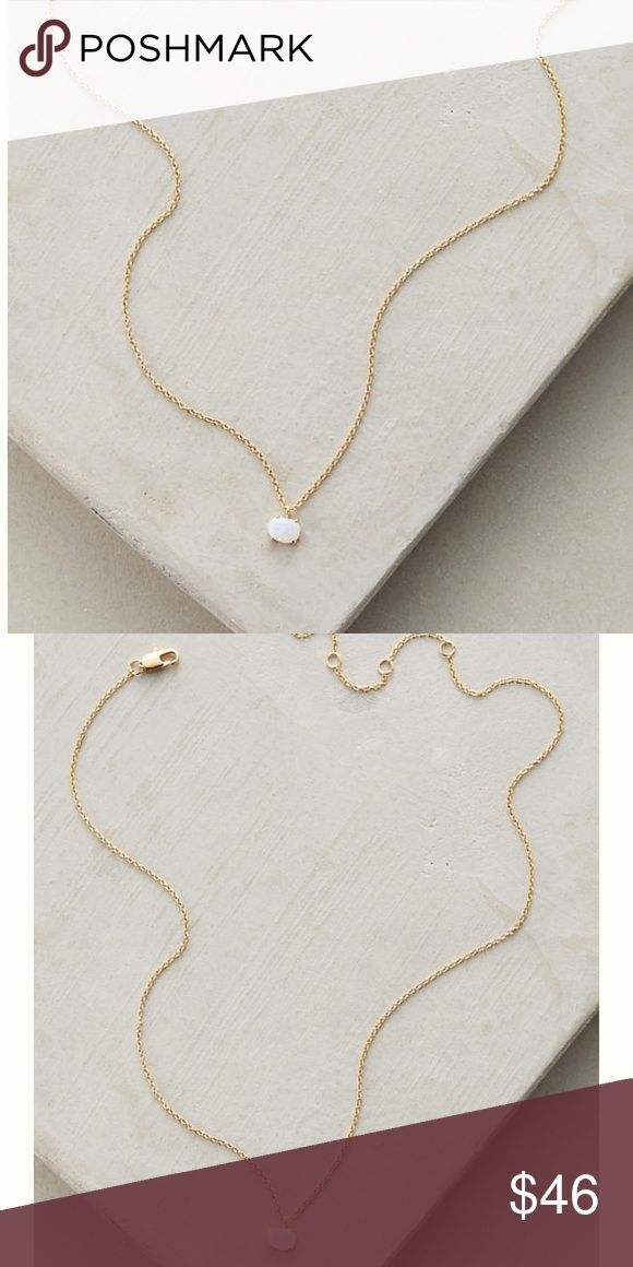 """Anthropologie • Dainty Opal Necklace Lovely and subtle opal stone on a dainty gold chain. Comes with a jewelry pouch. 12K gold, opal. ✨Price Firm.  Lobster clasp closure Dimensions : 14""""L with 2"""" extender chain Anthropologie Jewelry Necklaces"""
