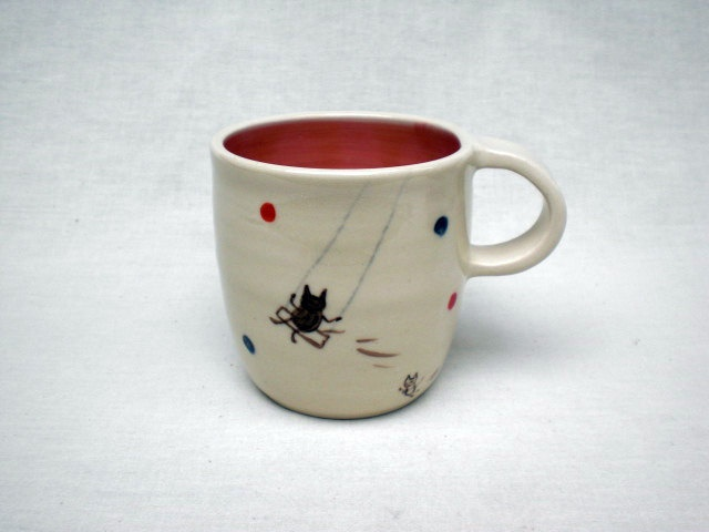 handmade mug with a kitty on a swing (!) $28 from KoideStudio on Etsy