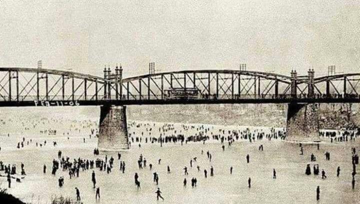 Ice skating on a frozen Ohio River under the old Bridgeport Bridge on 2/11/1906.