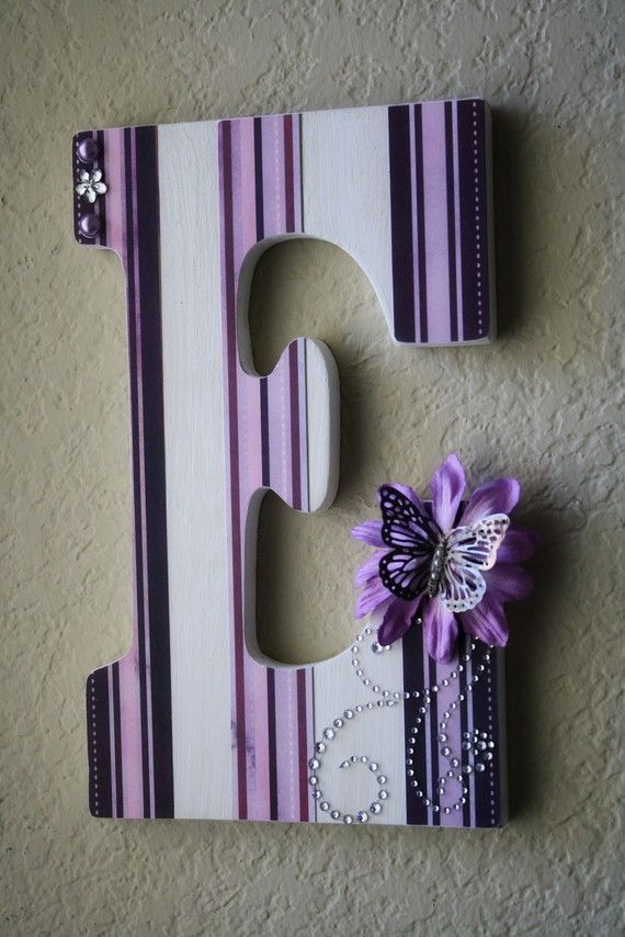 This is more for a kids room but you can buy these letters cheap at Michael's and cover them with any craft paper.. With your initial for your new last name. It would be pretty on the guestbook table or hung on the wall..?