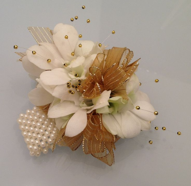 White Dendrobium Orchids with Pearl Bracelet Corsage.  Terra Flowers Miami. Perfect for Weddings, Proms or Graduations. Please visit www.TerraFlowersMiami.com for ordering details.
