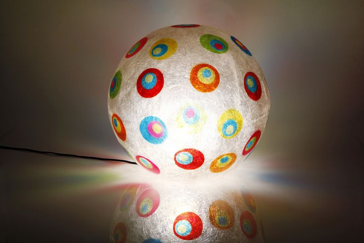 """Spot-in-Spot"" - Κρεμαστό/επιδαπέδιο φωτιστικό    Handmade fiberglass ball lamp  Fiberglass material is robust and lightweight  It can be hang from the ceiling as the central light of the space, or be put on the floor/any surface as a floor/desk lamp  Diameter: 40cm, or 30cm  The ball's background colour is Natural White, while its design has yellow, fuchsia, blue, green, purple and orange colours."