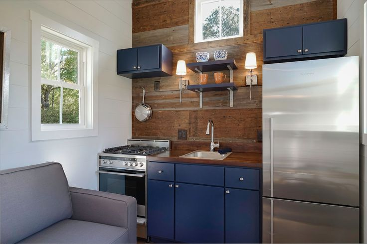 This Tiny House Breaks a Major Decorating Rule Love the blue and wood.