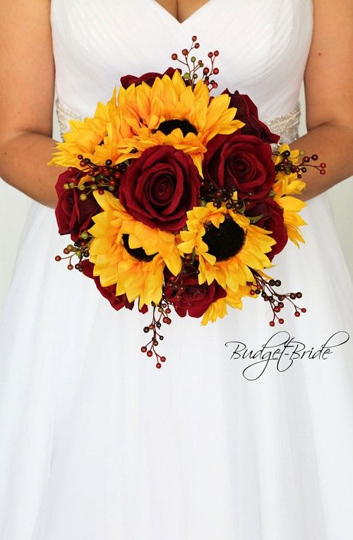 Sunflowers and dark red roses accented with red berries, perfect wedding flower …