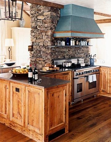 the stone is a wall between the kitchen and family room, and also a chimney for the fireplace that faces the family room- love it!