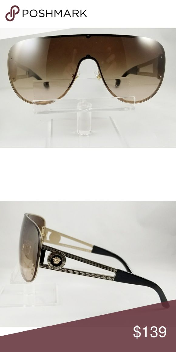 New  Versace aviator sunglasses New Authentic Versace aviator sunglasses.  Frames are pale gold with Brown gradient lenses.  Media logo on side of temples. 41-140 Comes with our brand case Versace Accessories Sunglasses