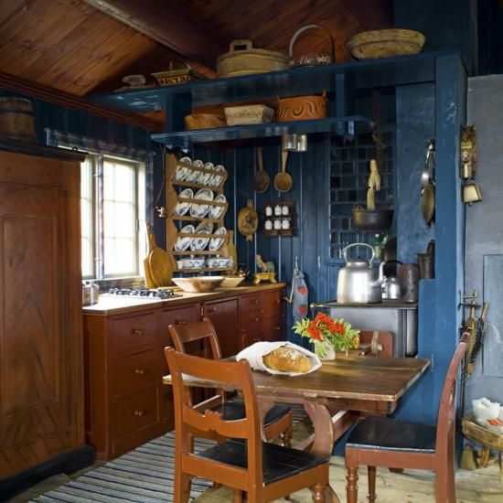 "Author Else Rønnevig created the special interiors in this compact cottage in Bergen, Norway. The house consists of one main living area. It has a sleeping alcove with two rustic doors in front, which were taken from an old cabinet. The traditional flax (linen) oil paint is solvent-free, and is made in the traditional color ""Old Norwegian Blue."" Photo: Espen Grønli."