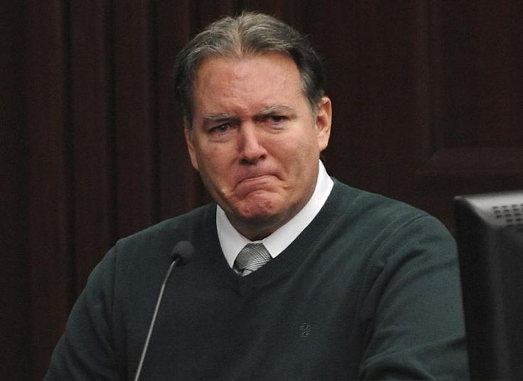 Michael Dunn testifies in his own defense in the Duval County Courthouse in Jacksonville, Fla., on Feb. 11.