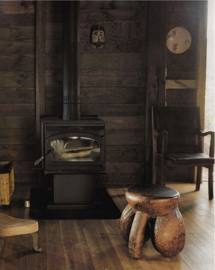 reclaimed wood wall behind fire place.