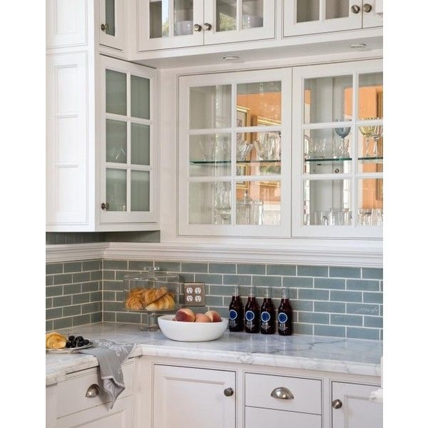 Blue glass subway tiles backsplash white glass-front kitchen cabinets Artistic Designs for Living Love blue glass found on Polyvore