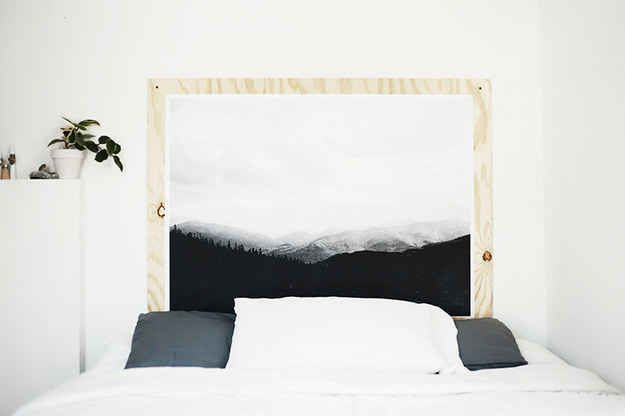 Construct a headboard you can display art on. When you get tired of one print, just swap it out