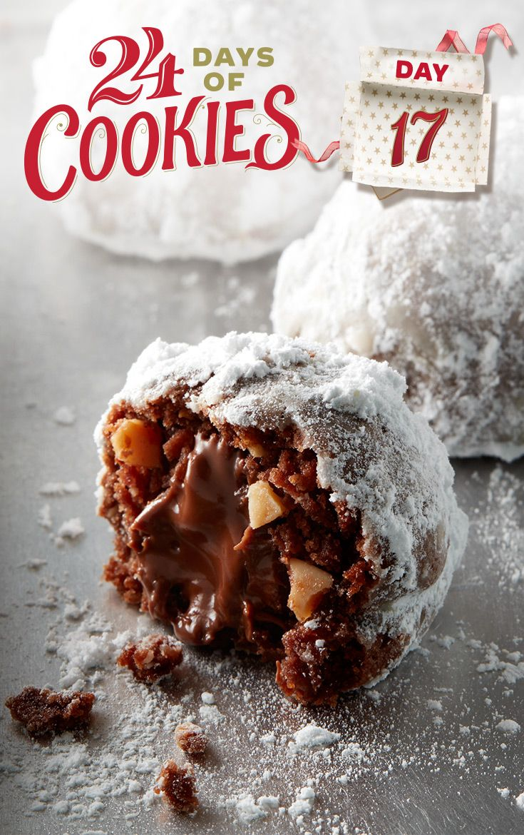 Wrap up the fun with a chocolaty twist on traditional Russian tea cakes! Sugar cookie mix stuffed with a gooey Hershey's™ Kiss™ and finely chopped almonds and rolled in powdered sugar make these delights melt-in-your-mouth delicious.