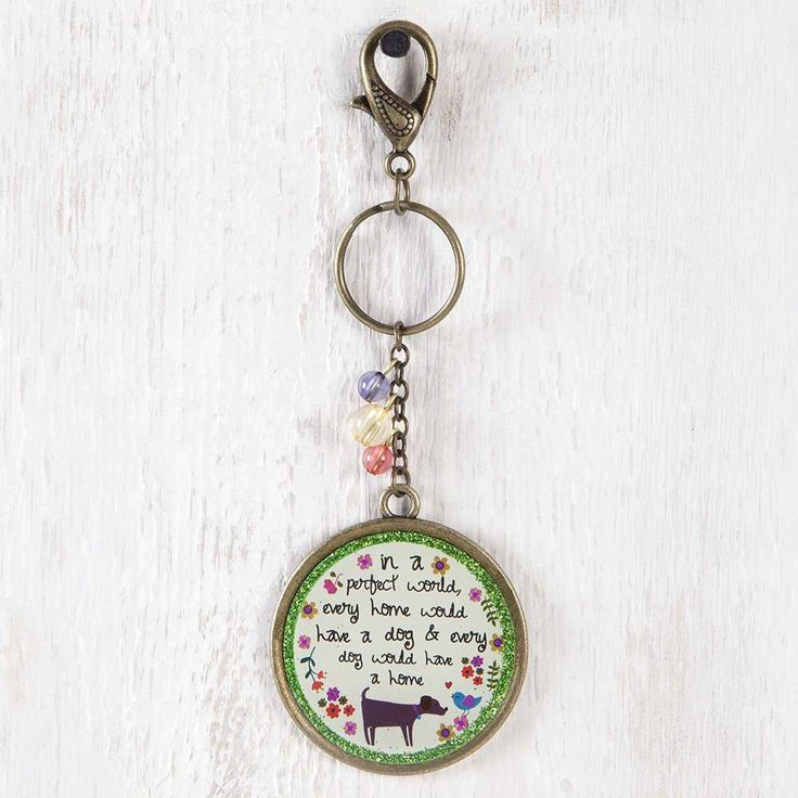 Perfect Dog World Glitter Key Chain - Carry your keys with style! These Glitter Keychains have fun glitter embellishments and feature colorful  beads on chain. Includes key ring and clip. Makes a perfect gift! ALL SALE ITEMS ARE FINAL SALE. Please refer to our Return Policy for more information.