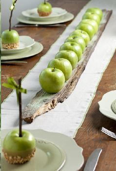 Love this simplistic table. Green apples on wood.