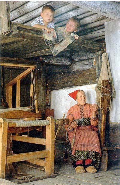 Illustration of the archaic way of life in one of the Russian regions. Spinning woman is an integral part of such life