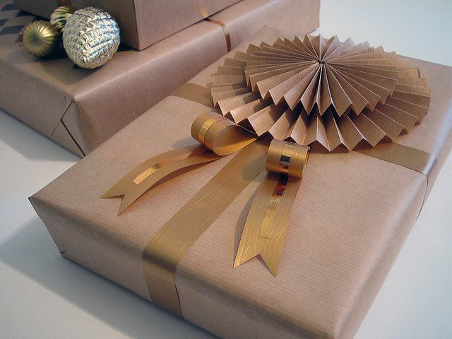 Kraft paper folded medallions add texture to plain paper wrapping. #giftwrap
