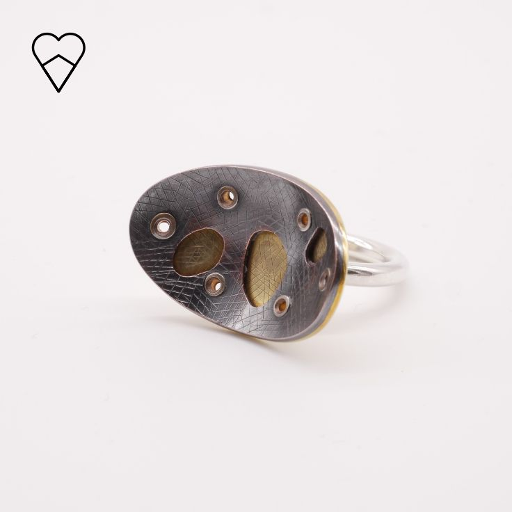 Rivetted ring. Silver, brass, copper, patina.