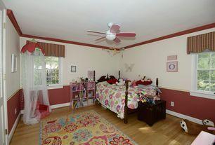 Traditional Kids Bedroom with Hardwood floors, Chair rail, Carpet, flush light, Ceiling fan, Crown molding
