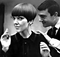 Mary Quant having her hair done by stylist Vidal Sassoon, who originated her hairdo, known as the bob, a short, angular hairstyle cut on a horizontal plane.